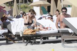 http://img23.imagevenue.com/loc251/th_312345443_Mischa_Barton_Bikini_Candids_on_the_Beach_in_Miami_December_27_2011_173_122_251lo.jpg
