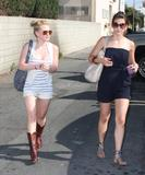 Hilary Duff shows her legs in shorts and boots and her nice cleavage (downblouse) in low-cut top in Beverly Hills