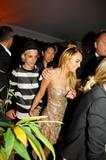 Lindsay Lohan showing legs and cleavage in gold low-cut and very short dress and girlfriend DJ Samantha Ronson are seen boarding on a Cannes yacht to attend a private party.